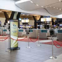 Empty SAA check-in counters are seen at the O.R. Tambo International Airport in Johannesburg last month. | AFP-JIJI