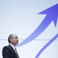 Masayoshi Son, chairman and chief executive officer of SoftBank Group Corp., holds a news conference in Tokyo on Nov. 6. | BLOOMBERG