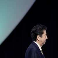 Prime Minister Shinzo Abe leaves the stage during the ruling Liberal Democratic Party's annual convention in Tokyo in February. | BLOOMBERG