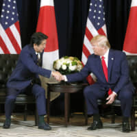 Prime Minister Shinzo Abe and U.S. President Donald Trump hold talks in New York on Sept. 25. | KYODO