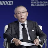 Tadashi Yanai, chairman and chief executive officer of Fast Retailing Co., speaks at the 21st Nikkei Global Management Forum in Tokyo in October. | BLOOMBERG