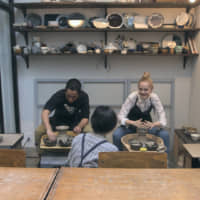 Take a spin: Kai (left) and Vivi spend an afternoon making bowls using pottery wheels on 'Terrace House Tokyo 2019-2020.' | © FUJI TELEVISION / EAST ENTERTAINMENT