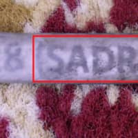 The name of a company believed by U.S. government authorities to be associated with Iran, SADRA, is seen on a wiring harness label from the wreckage of the Sept. 14 attack on an Aramco oil facility in Saudi Arabia in this handout image provided by a U.S. government source. | U.S. GOVERNMENT / HANDOUT / VIA REUTERS