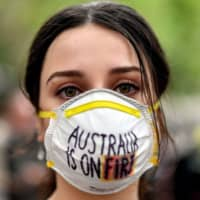A demonstrator at a climate rally in Sydney on Wednesday | AFP-JIJI