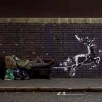 Homeless Santa? Banksy reindeer mural goes viral amid rough sleeping crisis