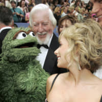 Actress Jamie Foley greets Caroll Spinney, the puppeteer and voice of muppet characters on TV's Sesame Street and 'Oscar the Grouch,' as they arrive at the 33rd annual Daytime Emmy Awards in Hollywood, California, in 2006. | REUTERS
