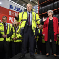 British Prime Minister Boris Johnson talks during a question and answer session, part of a general election campaign visit to Ferguson's Transport in Washington, England, Monday. | BEN STANSALL / POOL PHOTO / VIA AP