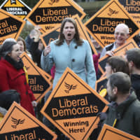 Liberal Democrat Leader Jo Swinson meets supporters during a visit, while on the general election campaign, in Sheffield, England, Sunday. Britain goes to the polls Thursday.   DANNY LAWSON / PA / VIA AP