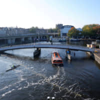 Amsterdam trials 'bubble barrier' to clean river of plastic waste