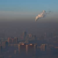 Emissions from a power plant rise over Ulaanbaatar, Mongolia, in 2017. | REUTERS