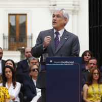 Chilean President Sebastian Pinera speaks at La Moneda presidential palace in Santiago on Monday during a ceremony to enact a law that enables a constitucional plebiscite. | RAMON MONROY / ATON CHILE / VIA AFP-JIJI