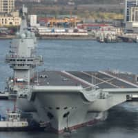 China's first domestically built aircraft carrier departs for its ninth sea trial in Dalian, Liaoning province, on Nov. 14. | REUTERS