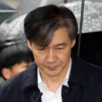 Former South Korean Justice Minister Cho Kuk arrives at a court in Seoul last Thursday to attend a hearing for reviewing the prosecution's detention warrant. | REUTERS