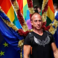 A reveller takes part in the annual Gay Pride parade, also called Christopher Street Day parade, in Berlin on July 22, 2017. | REUTERS