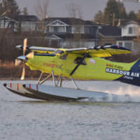 Harbour Air CEO Greg McDougall flies the world's first all-electric, zero-emission commercial aircraft during a test flight from Vancouver International Airport in Richmond, British Columbia, on Tuesday. | AFP-JIJI