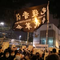 Hong Kongers gather outside a detention center in Lai Chi Kok to demand the release of protesters on Friday. | REUTERS
