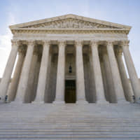 The Supreme Court in Washington is seen in June. The Supreme Court will not review an appellate decision that makes it harder for cities to keep homeless people from sleeping on the streets. The justices on Monday did not comment as they left in place a ruling that struck down a Boise, Idaho, ordinance. | AP