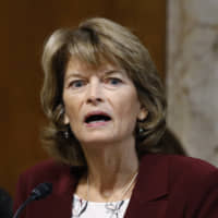 Sen. Lisa Murkowski, chair of the Senate Energy and Natural Resources Committee, speaks during a Dec. 19 hearing on the impact of wildfires on electric grid reliability, on Capitol Hill in Washington. Murkowski says she was 'disturbed' to hear Senate Majority Leader Mitch McConnell say there would be 'total coordination' between the White House and the Senate over the presidential impeachment trial. In an interview with KTUU, Murkowski said she remains undecided on how she would vote when the trial takes place. | AP