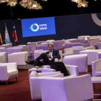 John Kerry, the former U.S. Secretary of State under the Barack Obama administration, sits during the COP25 summit in Madrid Thursday. Kerry praised young activists who he said are 'committed to hold adults accountable' on the issue of climate change, and criticized what he called Donald Trump's 'unpresidential' mockery of one of the movement's most prominent figures, Swedish teen Greta Thunberg. | AP