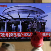 People in Seoul watch a TV news program Sunday reporting North Korea's announcement it carried out a 'very important test' at its long-range rocket launch site that U.S. and South Korean officials said the North had partially dismantled as part of denuclearization steps. | AP