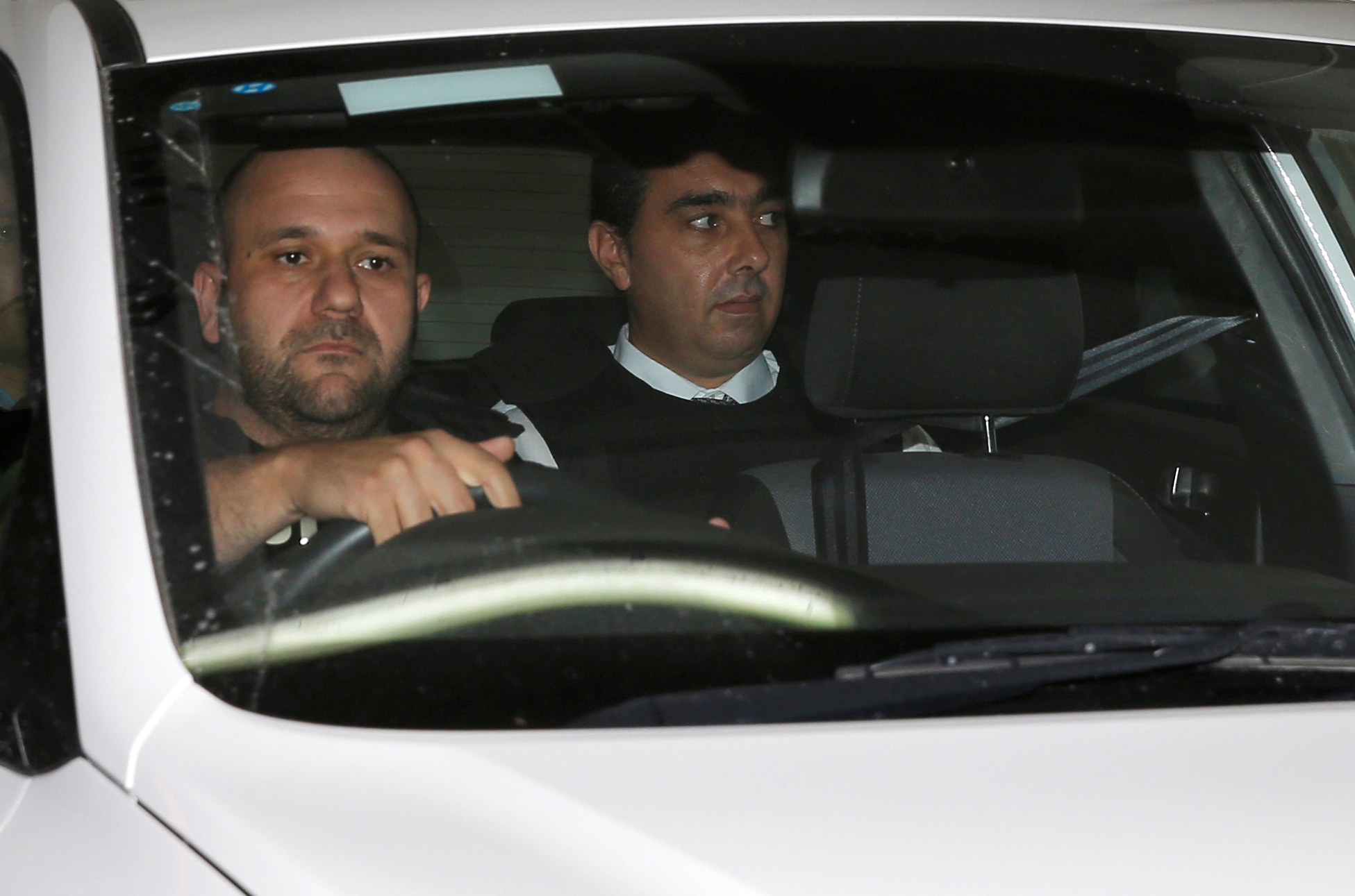 Melvin Theuma, who allegedly acted as a middle man in a plot to murder of journalist Daphne Caruana Galizia, is seen in a police car as he leaves the Courts of Justice in Valletta Wednesday. | REUTERS