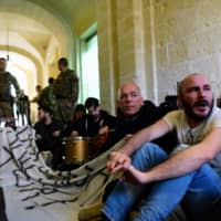 Activists continue to protest Monday after barging into the building of Prime Minister Joseph Muscat's office in Valletta, Malta, demanding his resignation in the wake of developments over the 2017 murder of anti-corruption journalist Daphne Caruana Galizia. | REUTERS