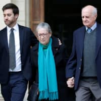 The son of Daphne Caruana Galizia, Andrew Caruana Galizia, and her parents, Rose Vella and Michael Vella, leave the Courts of Justice after a hearing of Melvin Theuma, who allegedly acted as a middle man in a plot to murder the journalist, in Valletta Wednesday. | REUTERS