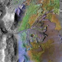 This picture taken by instruments on NASA's Mars Reconnaissance Orbiter (MRO) shows Jezero Crater on Mars, the landing site for NASA's Mars 2020 mission. | NASA / VIA AFP-JIJI