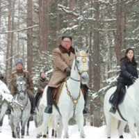 North Korean leader Kim Jong Un rides a white steed as he visits battle sites in the area of Mount Paektu in this undated picture released Wednesday. | KCNA / VIA REUTERS