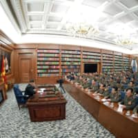 North Korean leader Kim Jong Un speaks during an enlarged meeting of the ruling party's Central Military Commission in this undated photo released Sunday. | KCNA / VIA REUTERS