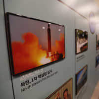 A photo showing a North Korean missile launch is displayed at the Unification Observation Post in Paju, South Korea, near the border with the North, on Friday. | AP