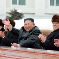 North Korean leader Kim Jong Un, accompanied by Pak Pong Ju, vice-chairman of the State Affairs Commission, attends a ceremony at the township of Samjiyon County in this undated picture released Tuesday. | KCNA / VIA REUTERS