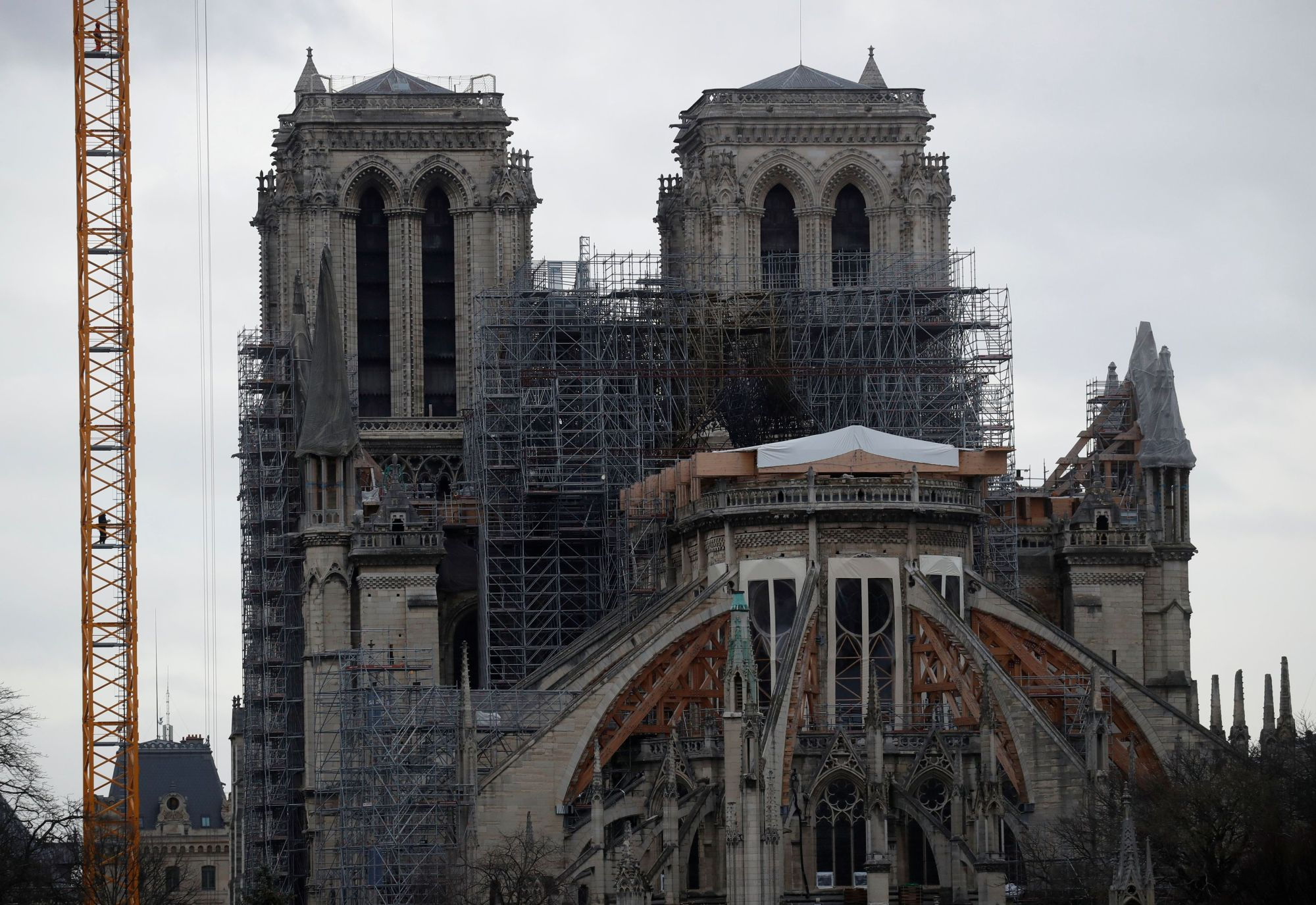 Work continues at the Notre Dame Cathedral in Paris Monday to stabilize the structure nine months after a fire caused significant damage. | REUTERS