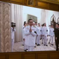 Following royal endorsement of Prayut Chan-ocha as Thai prime minister in Bangkok on June 11, images of the closed ceremony were broadcast on a screen for journalists. | BLOOMBERG