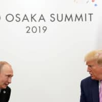 U.S. President Donald Trump meets with Russian President Vladimir Putin (left) at the G20 leaders summit in Osaka June 28. | REUTERS