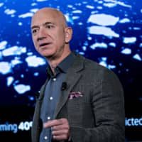 Even after a $9 billion divorce settlement, Amazon's Jeff Bezos is ending the year as the world's richest person. | BLOOMBERG