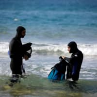 Israeli archaeologist Ehud Galili of the University of Haifa and his colleague prepare to dive in the Mediterranean Sea toward the area of Tel Hreiz where they believe an ancient seawall was erected, near Atlit, northern Israel, Wednesday. | REUTERS