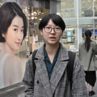 Yoon Ji-hye speaks during an interview in Seoul's Myungdong shopping district.
