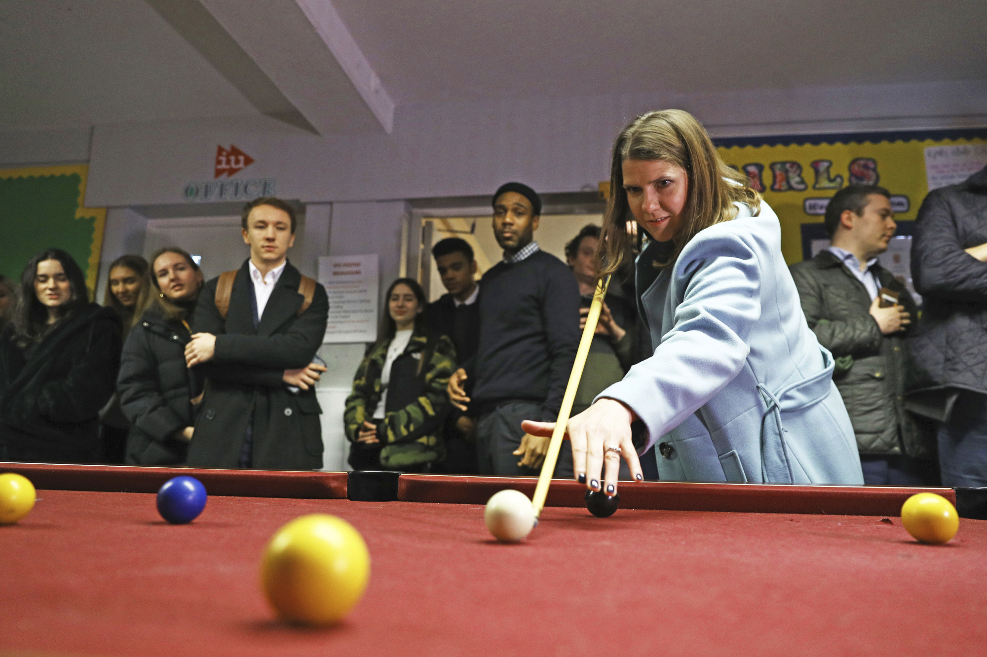 Liberal Democrats' leader Jo Swinson poses for a photo during a visit to Knights Youth Centre in London while on the general election campaign trail in London Wednesday. Britain goes to the polls on Dec. 12. | AARON CHOWN / PA / VIA AP