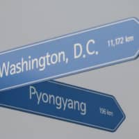 A signpost showing the directions and distances from Seoul to Washington and Pyongyang is displayed in a park in Seoul on Tuesday. North Korea on Monday accused U.S. President Trump of 'bluffing' and called him 'an old man bereft of patience' as Pyongyang ramps up pressure on Washington over stalled nuclear talks.   AFP-JIJI