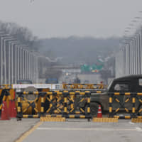 A military vehicle passes by the Unification Bridge, which leads to Panmunjom in the Demilitarized Zone in Paju, South Korea, Monday. U.S. Special Representative for North Korea Stephen Biegun said Monday that Washington won't accept a yearend deadline set by North Korea to make concessions in stalled nuclear talks and urged Pyongyang to return to a negotiating table immediately. | AP