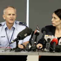 New Zealand Prime Minister Jacinda Ardern watches as police Superintendent Bruce Bird addresses a press conference in Whakatane, New Zealand, Tuesday. A volcanic island in New Zealand erupted Monday in a tower of ash and steam while dozens of tourists were exploring the moon-like surface, killing at least five people and leaving many more missing. | AP