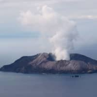 New Zealand police plan mission to recover bodies from volcano island