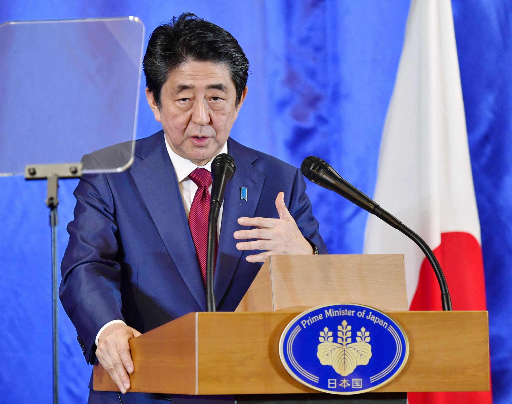 Prime Minister Shinzo Abe speaks at a news conference after holding talks with his Chinese and South Korean counterparts in Chengdu, China, last week. | KYODO