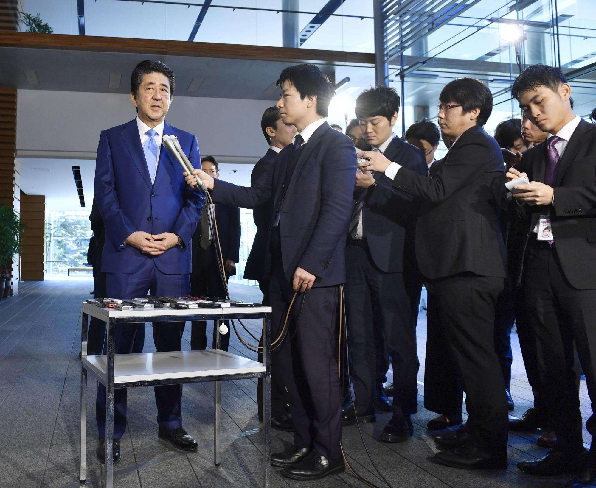 Prime Minister Shinzo Abe speaks during a briefing with reporters at the Prime Minister's Office in November. | KYODO
