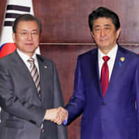 Japan and South Korea leaders vow to keep talking, but no progress made on wartime labor