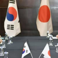 Abe-Moon talks and Seoul's donation plan could lead to improved ties, observers say
