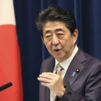 Prime Minister Shinzo Abe speaks during a news conference in Tokyo on Monday as the Diet session came to a close. | AP