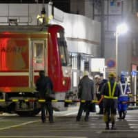 Police reconstruct fatal Yokohama collision between train and truck