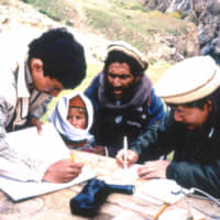 Japanese physician Tetsu Nakamura (right) provides medical treatment in Pakistan in the early 1980s. He was gunned down Wednesday in Afghanistan along with five Afghans. | PESHAWAR-KAI / VIA KYODO